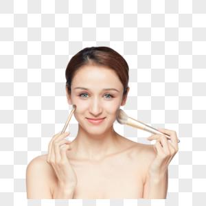 美女拿粉笔刷化妆图片