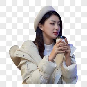 手捧咖啡杯的商务女性图片