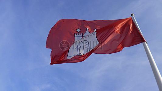 天空中飘逸的国旗图片