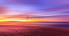 夕阳晚霞和海滩图片