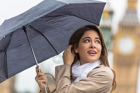 带着大本伞度假的女孩或年轻女游客,伦敦英国大列颠图片
