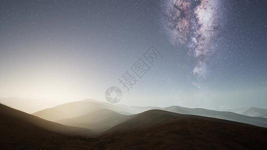 沙漠山脉上方的银河系恒星图片