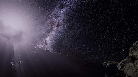 砂岩峡谷墙壁上的4k天体摄影星迹图片