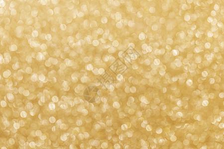 金色的节日闪光背景与离焦的灯光节日的闪光背景图片