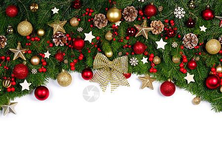 圣诞边框的树枝白色背景与隔离,红色金色装饰,浆果,星星圣诞树树枝的圣诞框架图片