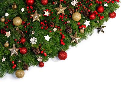圣诞边框的树枝白色背景与隔离,红色金色装饰,浆果,星星,圣诞树树枝的圣诞框架图片