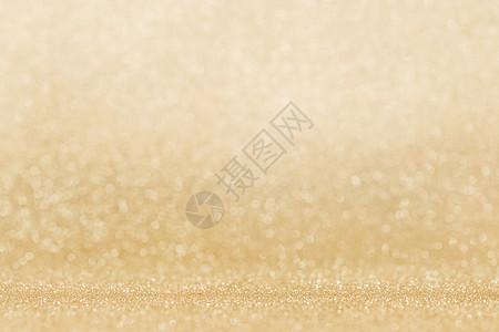 闪亮的金色波克闪光灯抽象背景,圣诞新年派庆祝闪亮的金色灯光背景图片