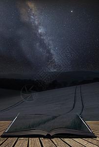 令人震惊的充满活力的银河复合图像夏季麦田的景观上页开放的故事书中出来图片