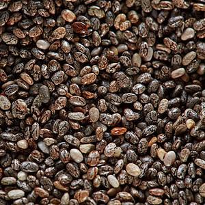 未煮熟的亚麻籽背景,顶部视图,高分辨率产品健康的超级食品俯视图亚麻天然机种子的纹理健康的原始超级图片