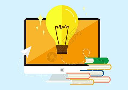 电脑灯泡和书图片