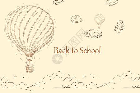 开学热气球草地石头背景图片
