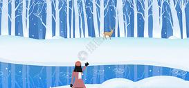 雪地树林里的鹿图片