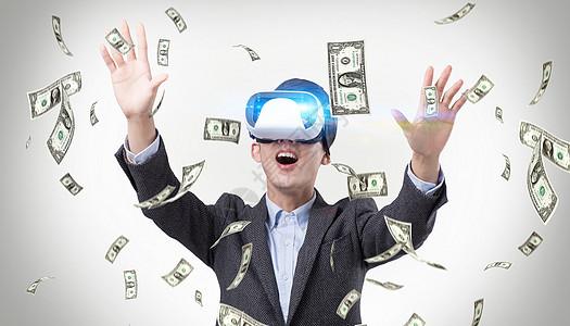 VR虚拟现实看飘落的美元图片