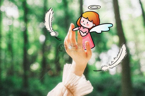 手中的天使创意摄影插画图片