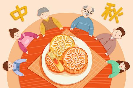 围着桌吃月饼的一家人图片