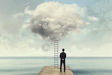 超现实梯子与商务人图片