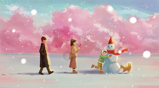 冬天家庭出游堆雪人图片