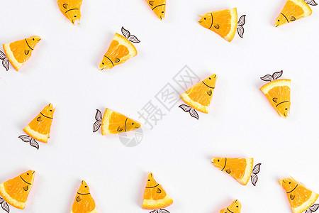创意橙子小鱼图片