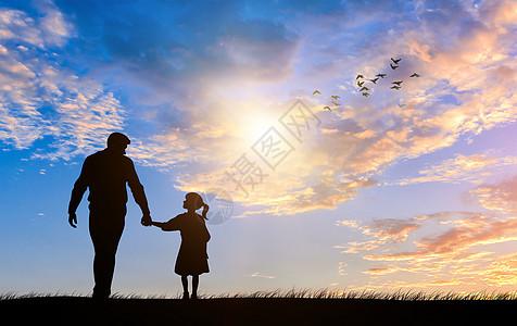 夕阳下的父女图片