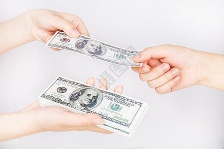 双手商业交易美元图片