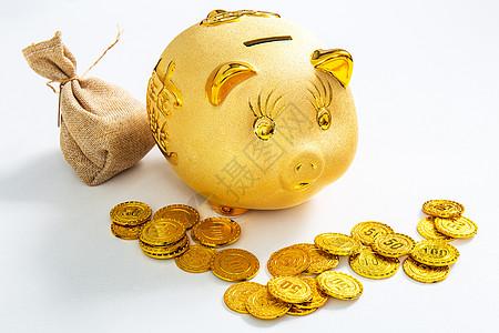 金融储蓄金猪存钱罐和一袋金币图片