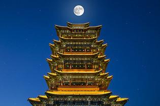 中国风古楼永定楼明月布景图片