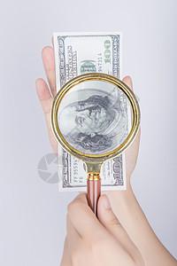 放大镜放大美元局部图片