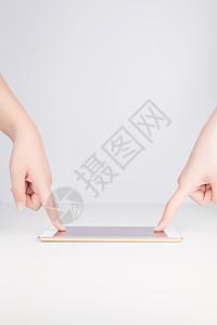 手指共同点击手机图片