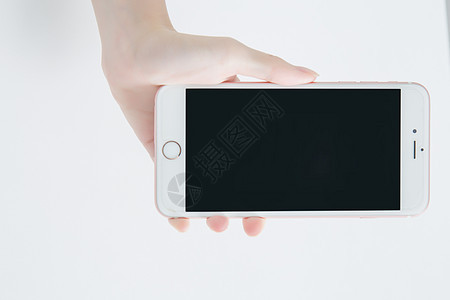 手拿手机图片