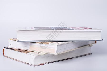 教育知识书本叠放摆拍图片
