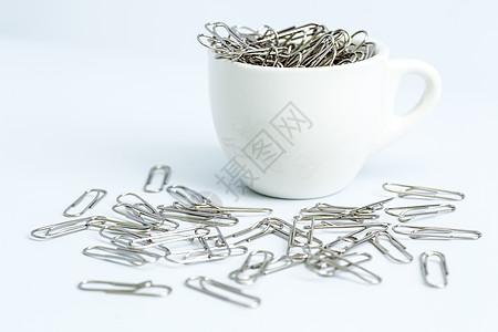教育设计回形针咖啡杯平铺创意拍摄图片