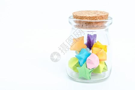 玻璃瓶彩色星星创意摆拍图片