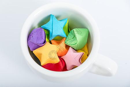 纸质星星咖啡杯创意摆拍图片