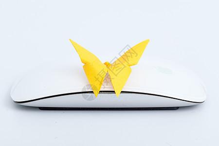 手工纸质蝴蝶鼠标创意拍摄图片