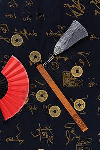 中国风红色纸扇铜钱书签摆拍图片