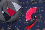 中国风礼品扇子穗子摆拍图片