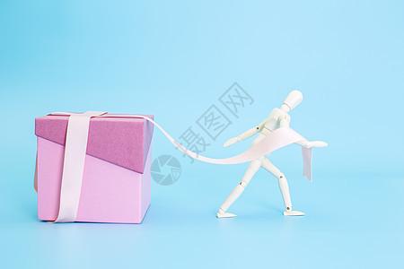 清新文艺木偶拉盒子礼带图片