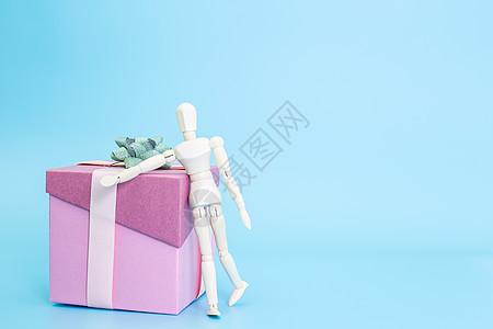 清新文艺木偶盒子礼带休息图片