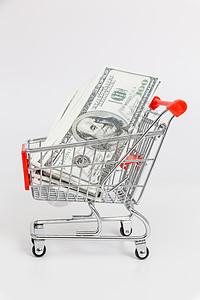 手推车与美元纸币图片