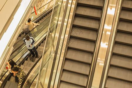 商场电梯男人女人上下图片