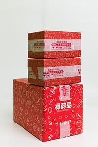 物流快递红色盒子叠放图片