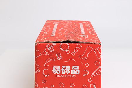 物流快递红色鞋子盒子图片