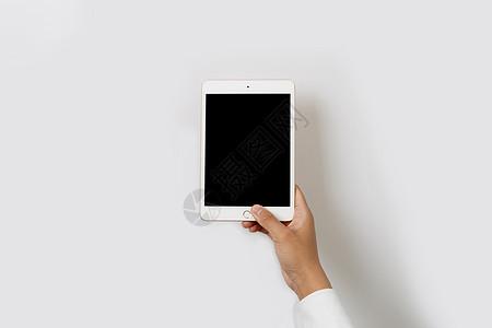 简洁商务风品单手拿平板图片