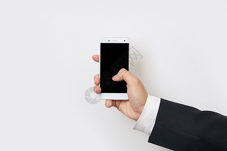 商务男单手持智能手机正面图片