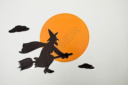 万圣节女巫骑着拖把背景素材图片