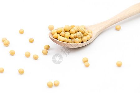 散落的黄豆和木勺图片
