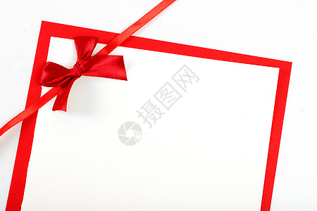 红色纸张与蝴蝶结图片