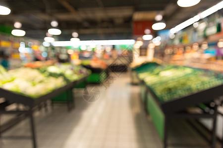 超市蔬菜摊位虚化场景图片
