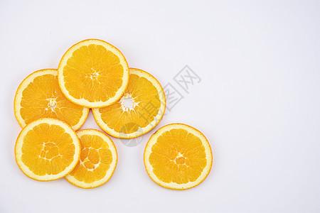 橙子背景水果切片摆拍图片