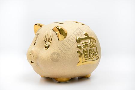 金色猪储蓄罐图片